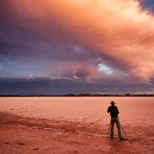 Photographer and photo adventures keader Ian Mckenziestanding in front of an approaching storm.